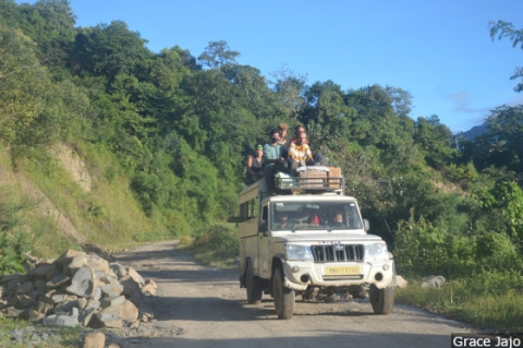 No state transport plies toward Leisang village, and villagers use private trucks or other overloaded shared vehicles.