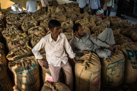 Farmers wait to sell their soybeans at a grain market in Burhanpur, Madhya Pradesh, India. (Photographer: Sanjit Das/Bloomberg)