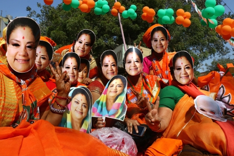BJP supporters wear masks of Rajasthan Chief Minister Vasundhara Raje in Ajmer, on  Dec. 5, 2018. (Photograph: PTI)