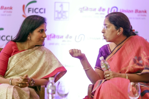 Chanda Kochhar, managing director and chief executive officer of ICICI Bank Ltd., left, and Shikha Sharma, managing director and chief executive officer of Axis Bank Ltd. (Photographer: Dhiraj Singh/Bloomberg)