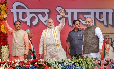 Prime Minister Narendra Modi with then-Chief Minister Shivraj Singh Chouhan and BJP President Amit Shah, in Bhopal, on Sep. 25, 2018. (Photograph: PTI)