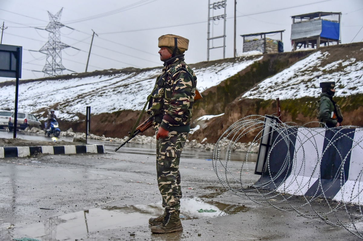 An army soldier stands guard near the site of the suicide bomb attack at Lathepora Awantipora in Pulwama district of Jammu & Kashmir, on Feb.  14, 2019. (Photographer: S Irfan/PTI)