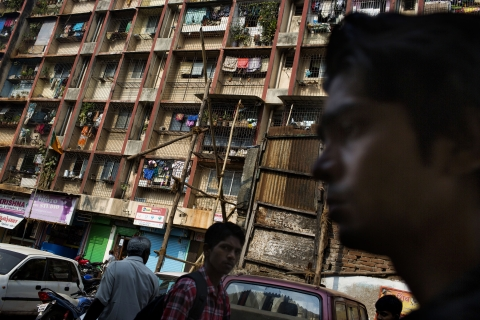 A slum redevelopment project building stands in the Dharavi slum area of Mumbai, India. (Photographer: Brent Lewin/Bloomberg)