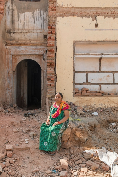 Nirmala Gupta's home is slated for destruction to make way for a new road leading to the temple. (Photographer: Anshika Varma for Bloomberg Businessweek)