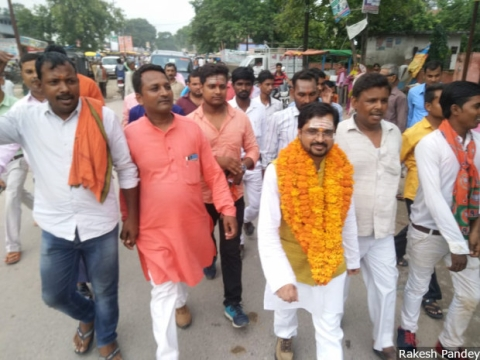 Rakesh Pandey (in white) participates in a rally in Uttar Pradesh's Kushinagar taken out to mark his initiation into the Bharatiya Janata Party's (BJP) IT cell. At age five, Pandey moved 840-km to his uncle's home to be able to study under a lamp. Moved by Anna Hazare's 2011 anti-corruption movement, he joined politics: He chose not the Aam Aadmi Party, but the BJP. (Photographer: Rakesh Pandey)