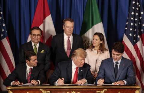 Enrique Pena Nieto, then Mexico's president, U.S. president Donald Trump, and Justin Trudeau, Canada's prime minister, sign the United States-Mexico-Canada Agreement, in Buenos Aires, on Nov. 30, 2018. (Photographer: Sarah Pabst/Bloomberg)