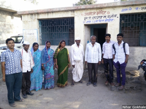 Dalit families gather near a community centre in Gharegaon in Maharashtra's Osmanabad district. Dalits own no land in the village and work as labourers on the farms of upper-caste farmers. During the region's recurring droughts, they migrate to western Maharashtra or to Mumbai in search of work.
