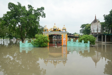 A temple is seen half submerged under flood waters, following heavy monsoon rain, in Kamrup district (Source: PTI)