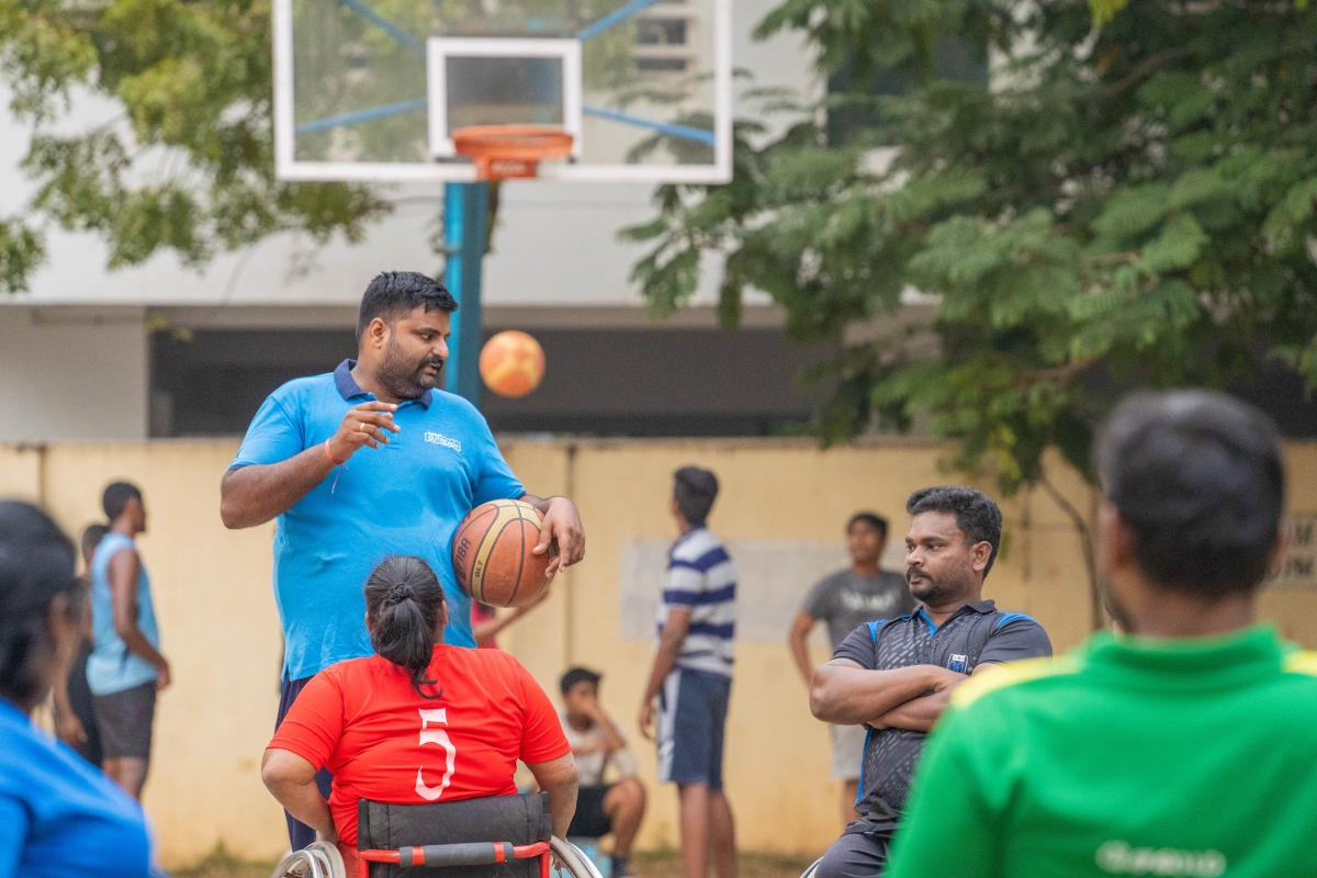 A volunteer  coaching a wheelchair-bound basketball team. (Photograph: Cognizant)