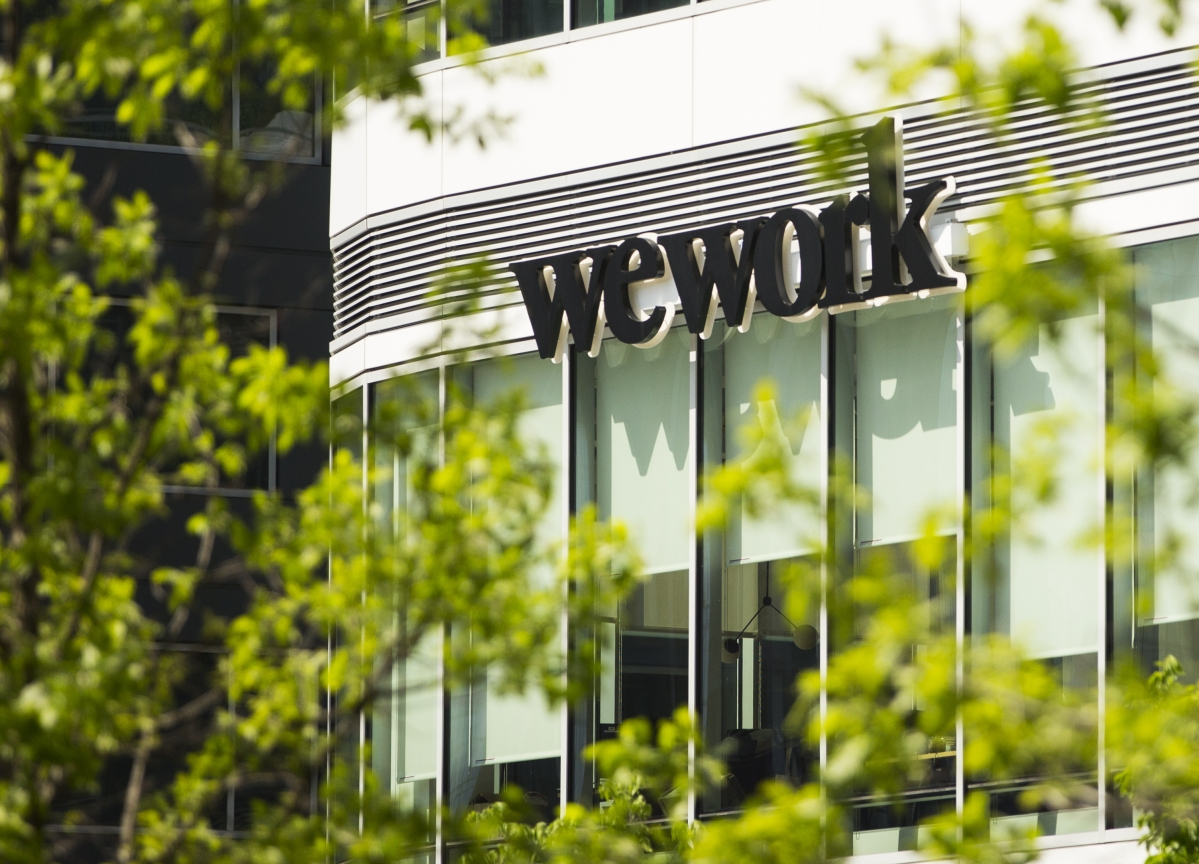 WeWork Yields Soar Over 10% After Rating Cut Deeper Into Junk