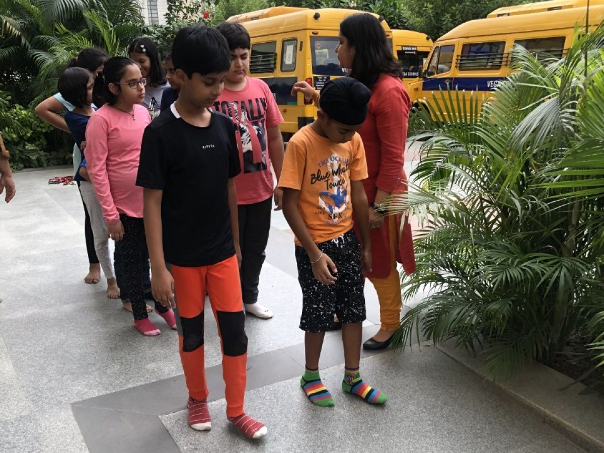 Young children and an Esha volunteer in a 'Blind Walk' session. (Photo: Esha)