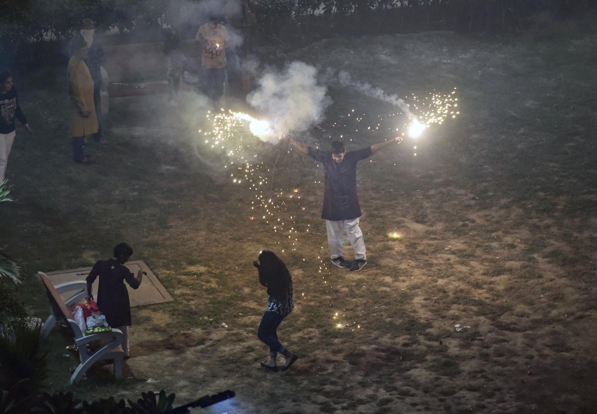 Smoke rises as people burn crackers during Diwali celebrations, in New Delhi on Sunday. (Photo: PTI)
