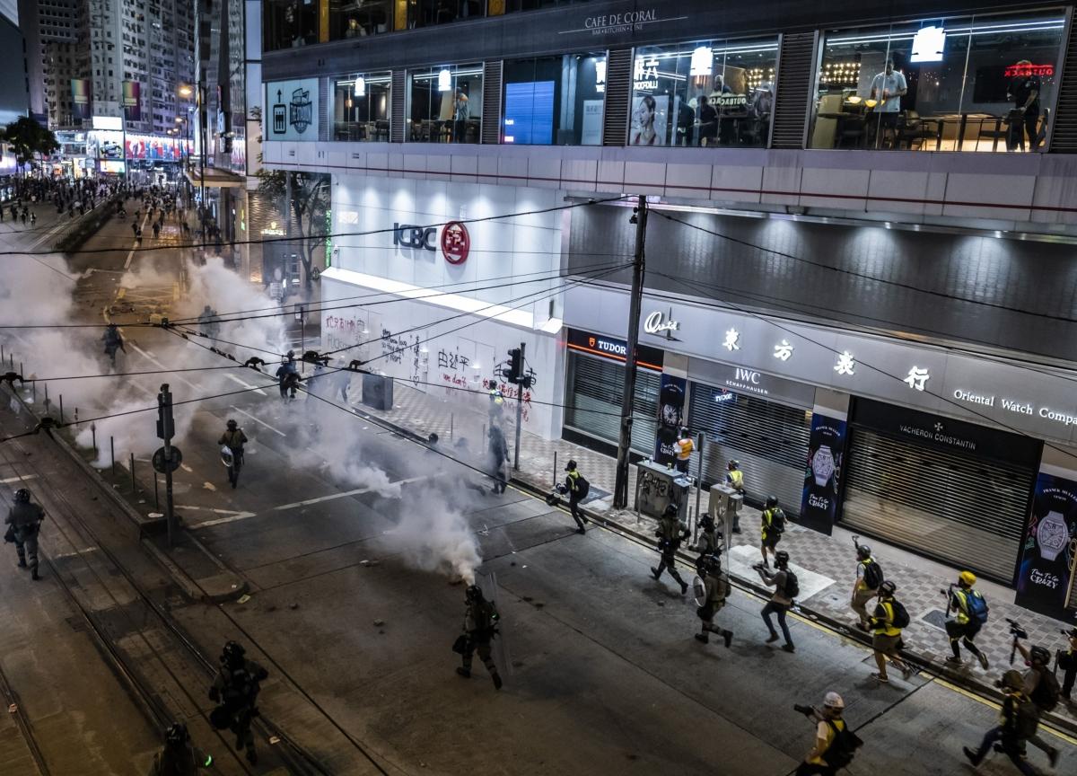 Hong Kong Violence Escalates With Bullets, Tear Gas, Man on Fire