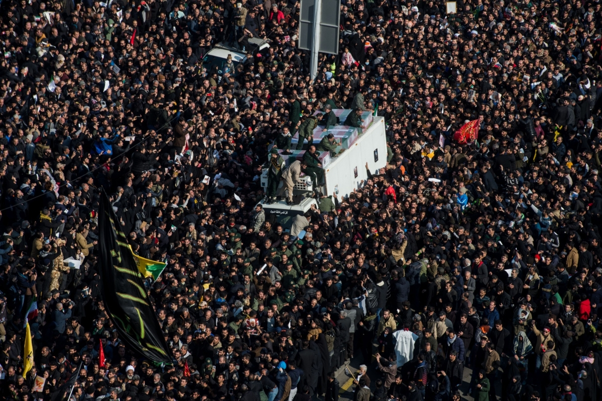Mourners surround the coffins of Iranian General Qassem Soleimani and others killed in the U.S. airstrike during a funeral ceremony in Tehran, Iran. (Photographer: Ali Mohammadi/Bloomberg)