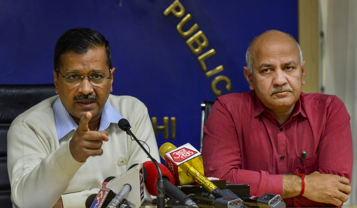 Delhi Chief Minister Arvind Kejriwal (L) gestures as he addresses a press conference, in New Delhi, Thursday, Feb 27, 2020. Delhi Deputy Chief Minister Manish Sisodia is also seen. (Source: PTI)
