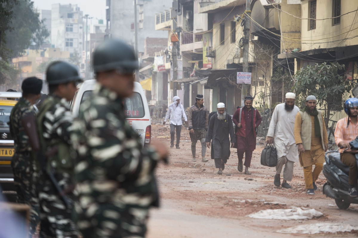 People leave their houses following the violence. (Source: PTI)
