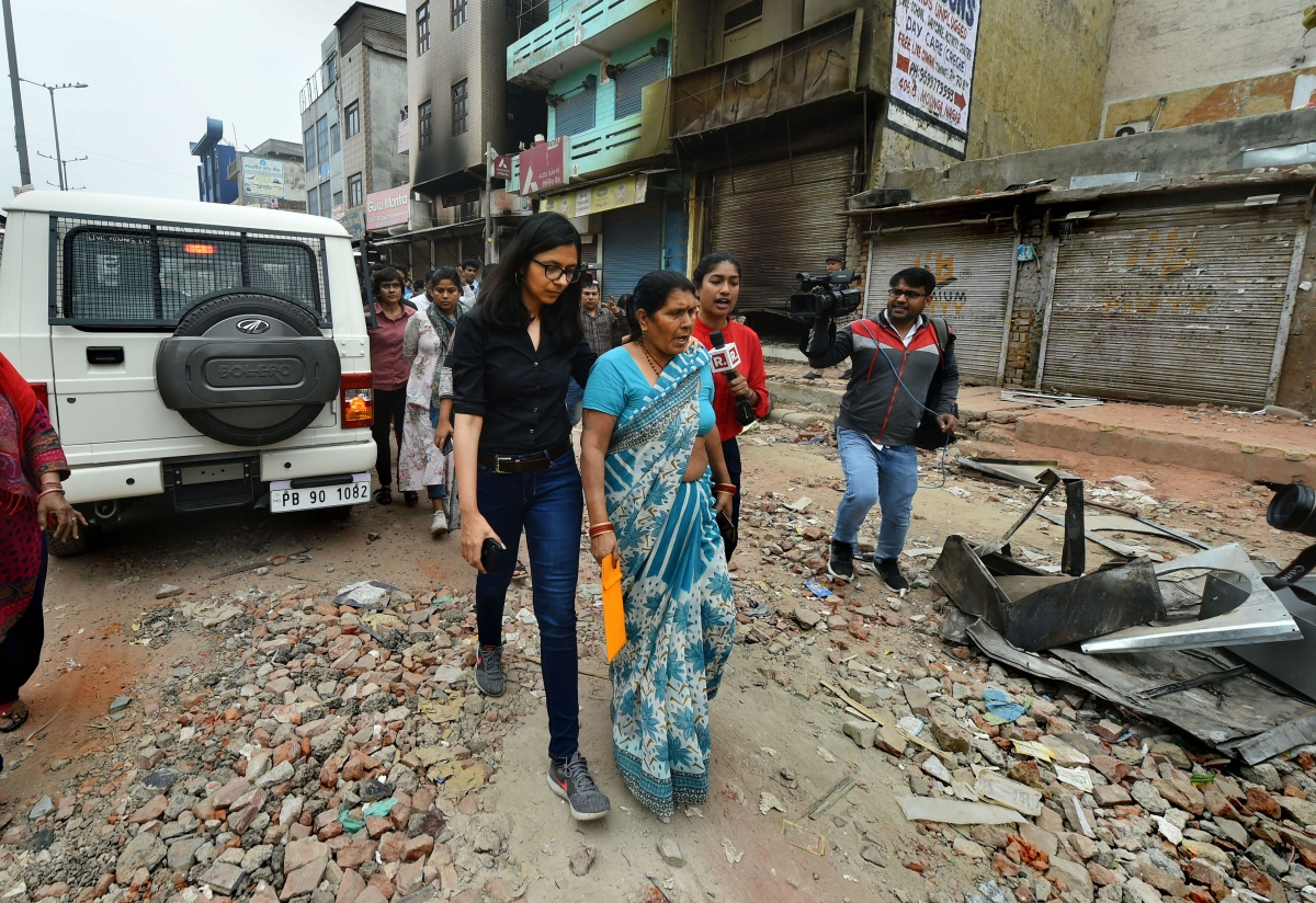 Delhi Commission for Women chief Swati Maliwal interacts with residents during her inspection at Khajuri Khas area of northeast Delhi on Thursday, Feb. 27, 2020. (Photo: PTI)