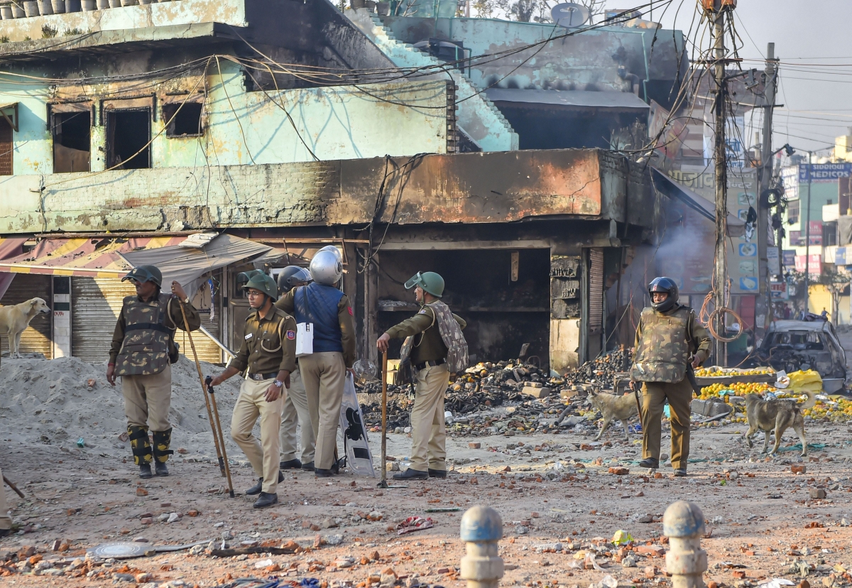 Security personnel stand guard near a neighbourhood vandalised by rioters (Source: PTI)