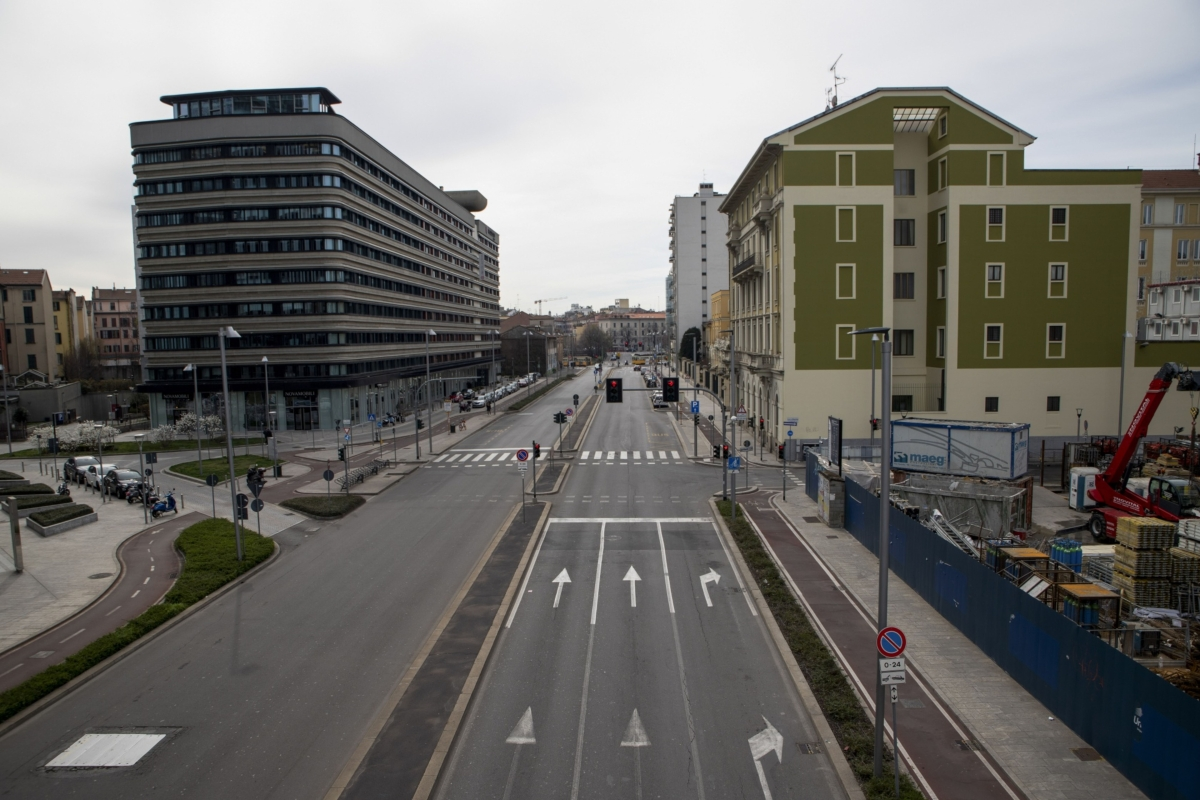 Via Melchiorre Gioia stands empty of traffic in Milan, Italy, on Tuesday, March 10, 2020. Italy became the first country to attempt a nationwide lockdown to stop the spread of the highly infectious coronavirus. (Photographer: Camilla Cerea/Bloomberg)