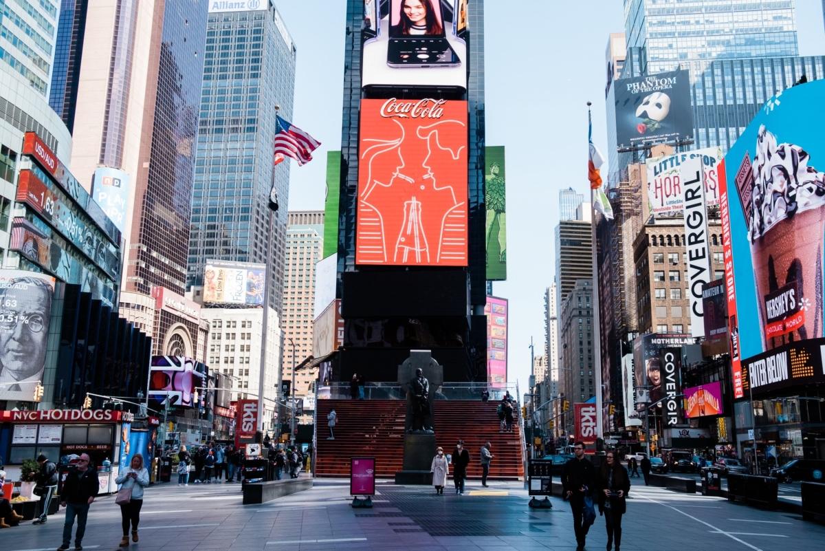 Pedestrians walk along a street in the Times Square neighborhood of New York, U.S., on Monday, March 16, 2020. (Photographer: Gabriela Bhaskar/Bloomberg)