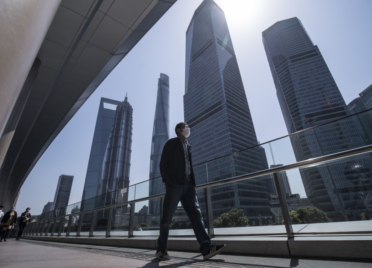 As Wall Street Empties, Asia's Bankers Slowly Head to Work