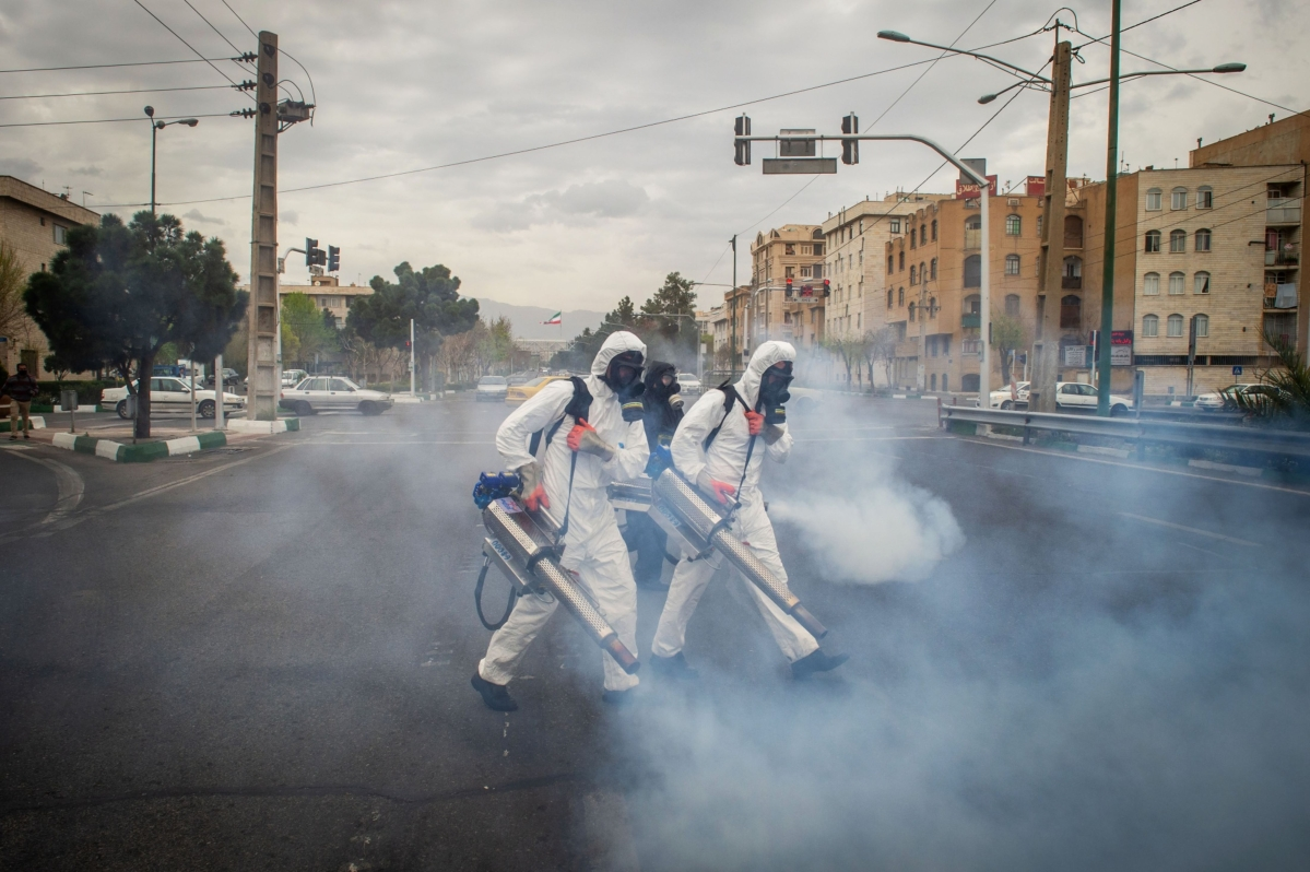 Firefighters use fog machines to disinfect public streets following the outbreak of coronavirus in Tehran, Iran, on Wednesday, March 18, 2020. Iran's health sector is already struggling to cope with the coronavirus epidemic, with 17,000 infected and more than 1,100 having died. (Photographer: Ali Mohammadi/Bloomberg)