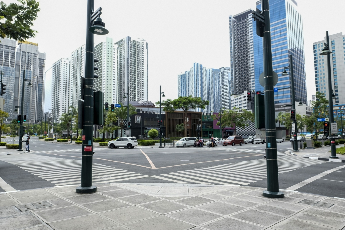 Vehicles travel through an intersection in Bonifacio Global City, Metro Manila, the Philippines, on Monday, March 16, 2020. The capital region started a lockdown from Sunday to contain the outbreak of the novel coronavirus amid a spike in cases. (Photographer: Veejay Villafranca/Bloomberg)
