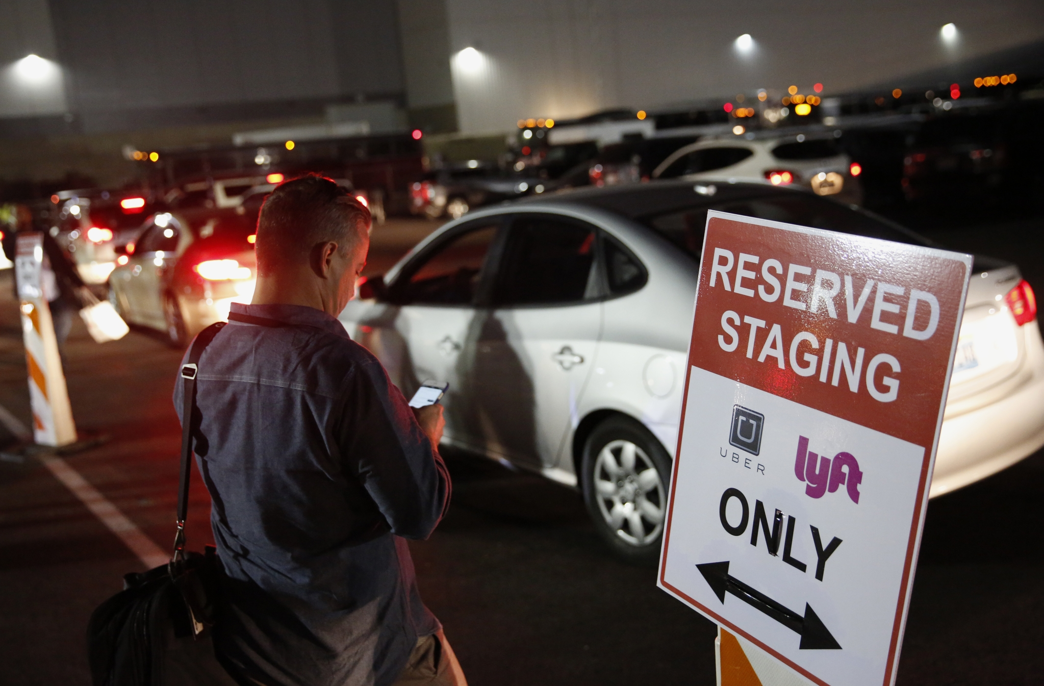 news articles lyft drivers accuse uber spying gain competitive edge