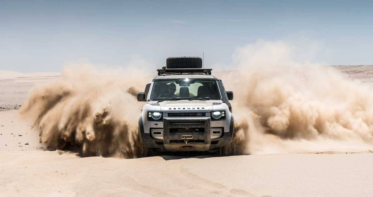 New Land Rover Defender tackling sand dunes in Namibia