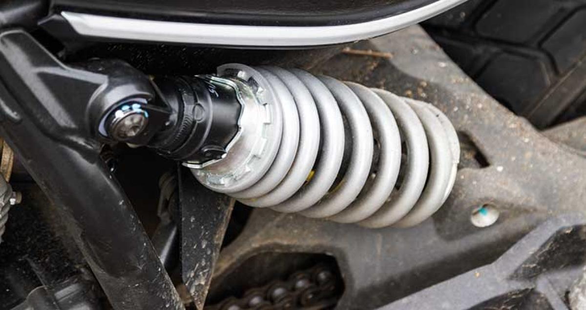 Ducati Scrambler driven through Mumbai's flooded streets