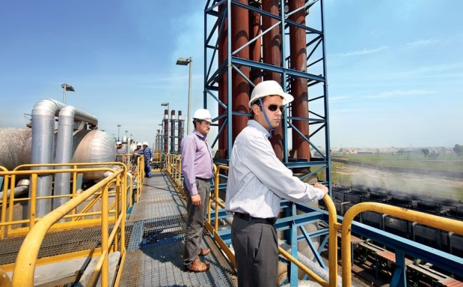 The Nishat Group produces more than 12% of the electricity generated in Pakistan. Seen here is Mian Mansha's youngest son, Hassan Mansha (in the foreground), who handles the group's power business, at one of the group's four plants, 60 kilometres from Lahore.