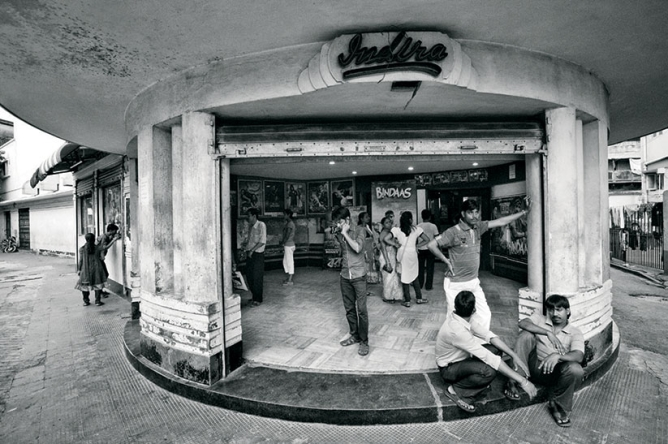 In the 2000s, commercial films—often with non-Bengali titles—gained popularity unmatched in the past two decades. (In this picture, people wait at Kolkata's Indira cinema before a show of SVF's Bindaas, released in July 2014.)