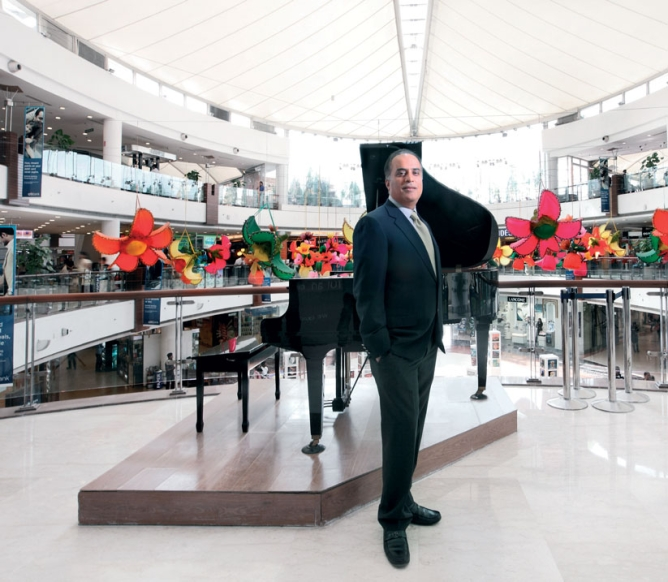 Arjun Sharma, director, Select CityWalk in Delhi, with the mall's central atrium, decorated for spring, in the background.