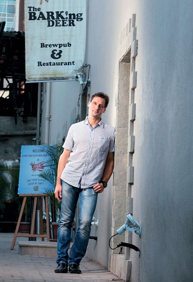 Gregory Kroitzsh, managing partner, Seven Islands Craft Brewery, which owns The Barking Deer brewpub.