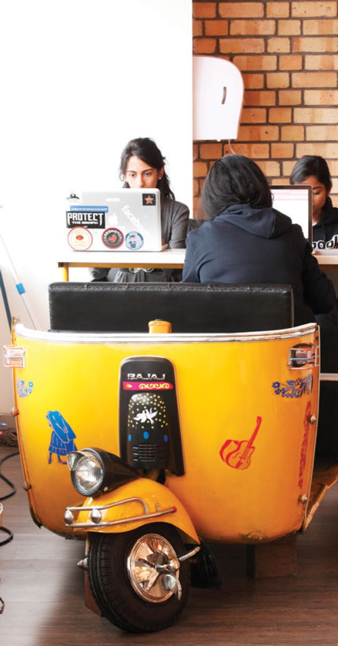 INSIDE FACEBOOK: The irreverant look of Facebook's Hyderabad office.<br /> An autorickshaw doubles as a workstation.