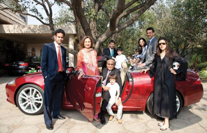 Mian Mansha with his sons and their families, in his Jaguar E-class convertible, outside the family home in Lahore.
