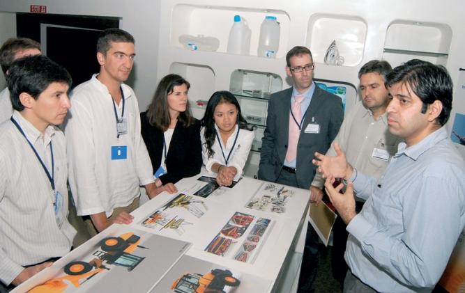 SHAPE OF THINGS TO COME: Tata Elxsi team members discuss an idea (top); a showcase of Tata Elxsi's work.