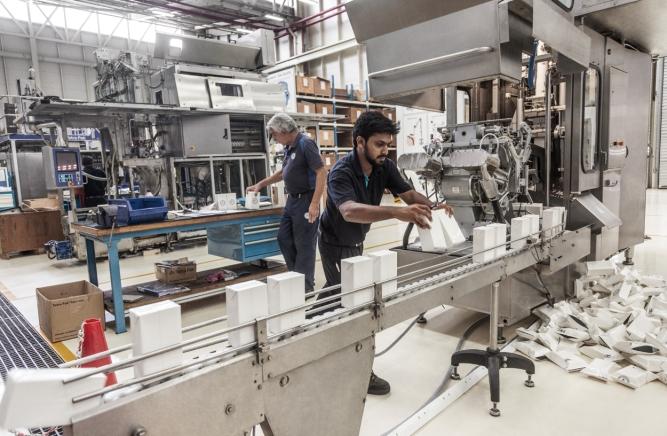 The making of a box at TetraPak's Chakan factory ; Photo by Narendra Bisht