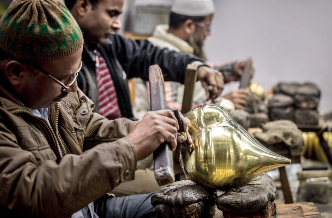 Workers at Khan's factory. Photo by Narendra Bisht