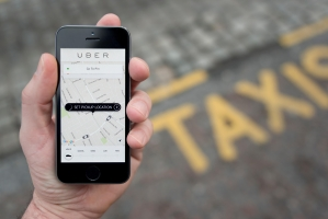 Uber ties up with SUN Mobility for e-auto fleet
