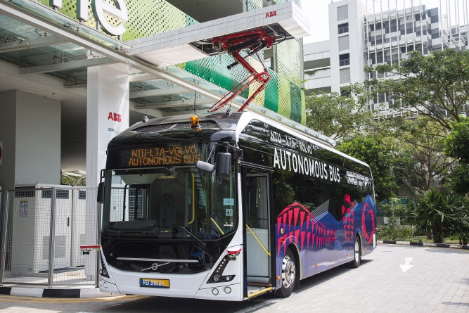 A Volvo AB 7900 electric autonomous passenger bus sits at a charging station atthe Centre of Excellence for Testing & Research of Autonomous Vehicles(CETRAN) of Nanyang Technology University in Singapore.