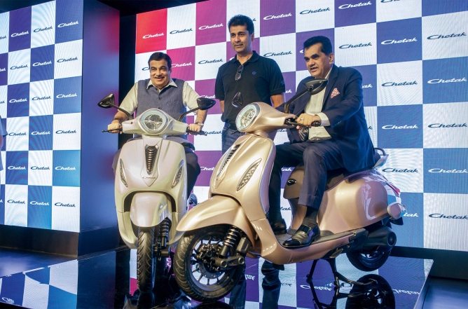 Nitin Gadkari, union minister for road transport and highways as well as micro, small and medium enterprises, Rajiv Bajaj, managing director of Bajaj Auto, and Amitabh Kant, CEO of NITI Aayog during the launch of Bajaj Auto's first electric scooter in New Delhi on October 16, 2019.