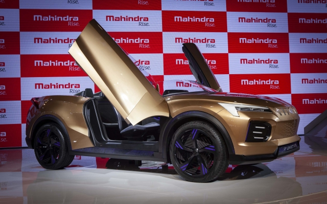 Mahindra Funster Electric Concept. it claims to have a range of 520 km per charge and can hit 100 km per hour in 5 seconds.