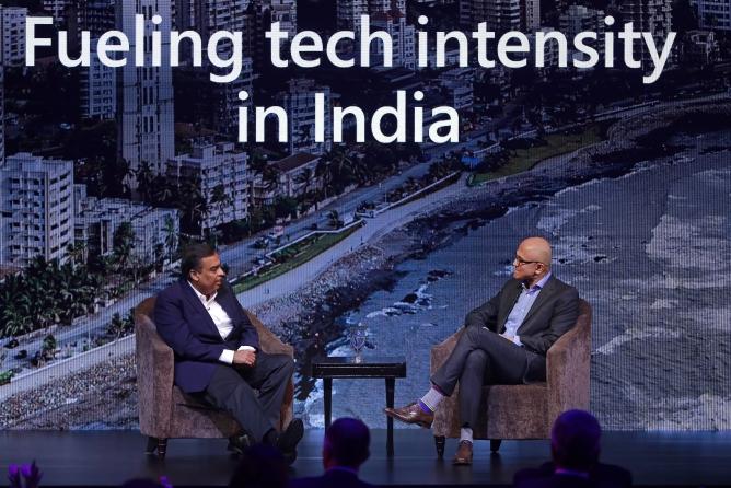 Mukesh Ambani, chairman, RIL (Left) and Satya Nadella during a fireside chat