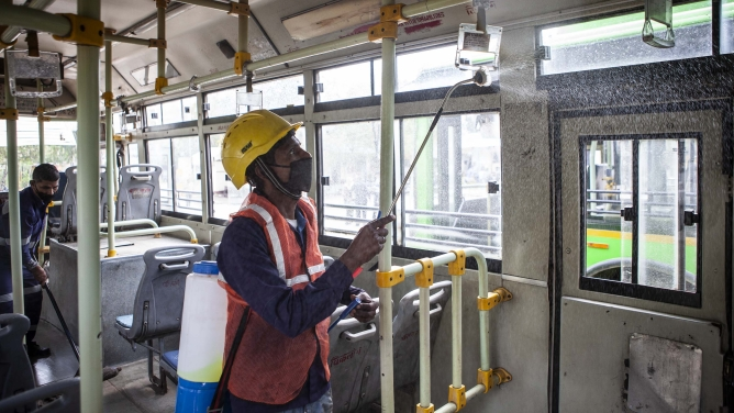 A worker disinfects a bus in New Delhi.