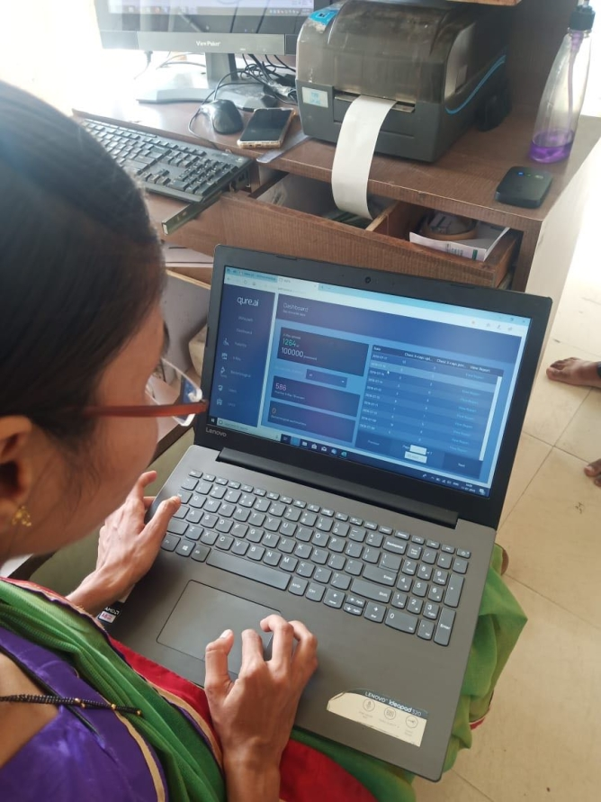 Health worker in a primary care centre using Qure's software