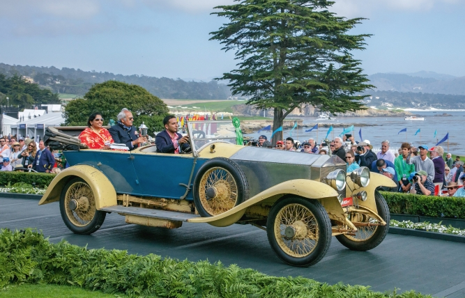 The 1921 Rolls-Royce Silver Ghost belonging to the Wankaner royal family, with the young Maharani of Wankaner and her father, the Maharaja of Sirohi seated inside, at the Pebble Beach Concours d'Elegance in California.