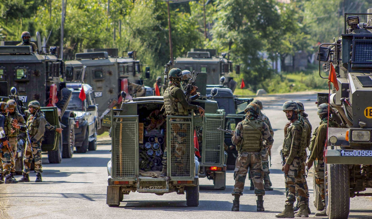 Army soldiers cordon off the area near the house where militants were hiding during an encounter in which one army Major and one militant were killed, at Achabal in Anantnag, Monday, June 17, 2019.