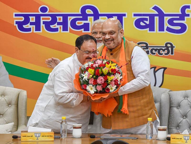 BJP President Amit Shah and newly-appointed BJP Working President JP Nadda with Narendra Modi, in New Delhi, Monday, June 17, 2019.