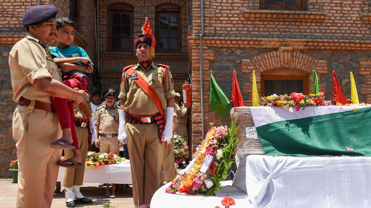 Police officer Arshad Khan's son Abuhan Khan pays tribute to his father during wreath-laying ceremony at District Police Lines, in Srinagar, Monday, June 17, 2019.